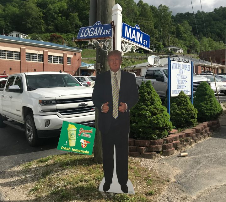 A cardboard cutout of President Donald Trump stands at a corner near Warren's event in Kermit on Friday. A small group of Tru