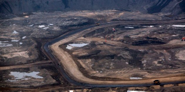 Oil is mined at Royal Dutch Shell Plc's Albian Sands mine near Fort McMurray, Alberta, Canada, on Tuesday,...
