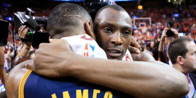 TORONTO, ON - MAY 27: LeBron James #23 of the Cleveland Cavaliers embraces Bismack Biyombo #8 of the...