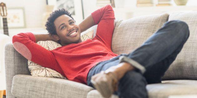 Man lying on sofa and