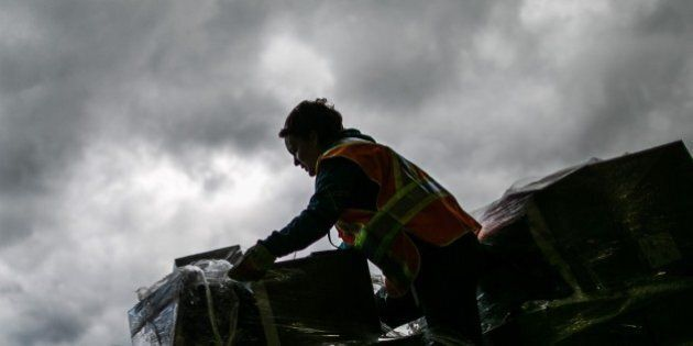 ALBERTA, CANADA - MAY 9 , 2016. A Volunteer loads donated items near Bold community center in Lac la...