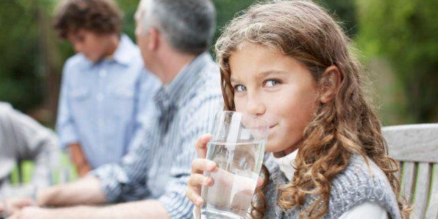 Girl drinking water at picnic
