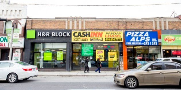 TORONTO, ON - FEBRUARY 27  -A payday loan store near the intersection of Weston Road and Lawrence avenue west.   ACORN Toronto is hosting a forum to discuss its campaign to get the City of Toronto to create a minimum distance separation bylaw between payday loans outlets to limit the number that can exist in certain areas.        (Carlos Osorio/Toronto Star via Getty Images)