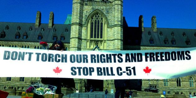 Toronto activists remind Canadians that Harper's proposed anti-terror Bill C-51 will torch rights and freedoms protected by the Charter during a protest on Parliament Hill, Ottawa, on Monday, March 23, 2015. Photo: OBERT MADONDO/The Canadian Progressive