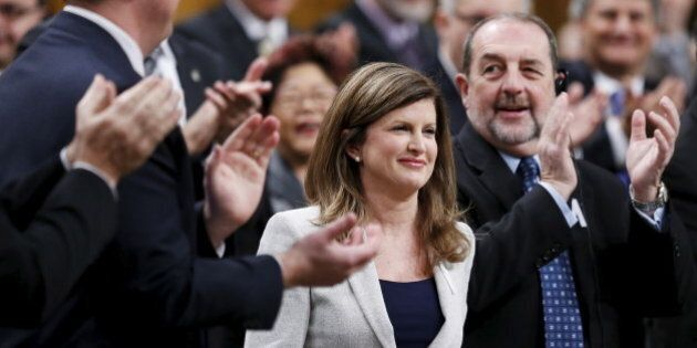 Interim Conservative Leader Rona Ambrose (C) receives a standing ovation from her caucus during a debate...