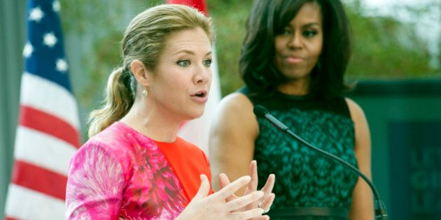 First lady Michelle Obama looks on as Sophie Grégoire-Trudeau, wife of Canadian Prime Minister Justin Trudeau, speaks during a program at the U.S. Institute of Peace in Washington, Thursday, March 10, 2016, to highlight Let Girls Learn efforts and raise awareness for global girl's education. (AP Photo/Cliff Owen)