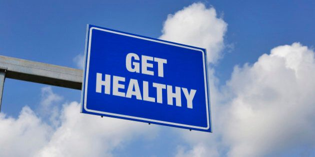 Get Healthy Just Ahead Road Sign with Clouds and