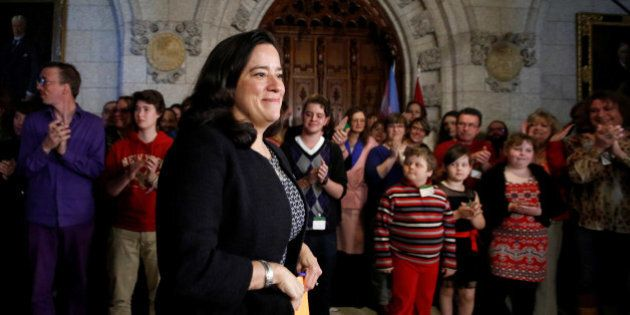 Canada's Justice Minister Jody Wilson-Raybould arrives at a news conference to announce legislation to...