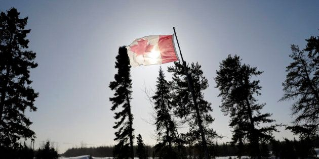 A Canadian flag flies over the Berens River in Berens River, Manitoba, Canada, on Thursday, Feb. 14,...
