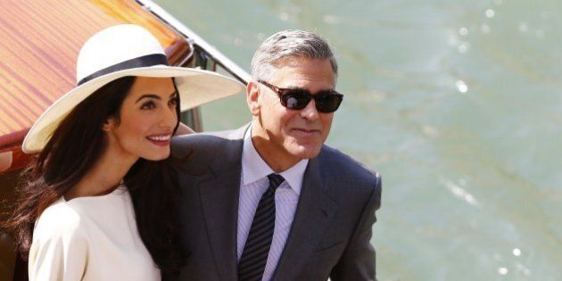 US actor George Clooney and British lawyer Amal Alamuddin leave the palazzo Ca Farsetti on a taxi boat...