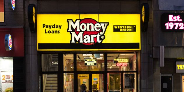 DOWNTOWN, TORONTO, ONTARIO, CANADA - 2015/08/23: People walking in front of a Money Mart store in Toronto....