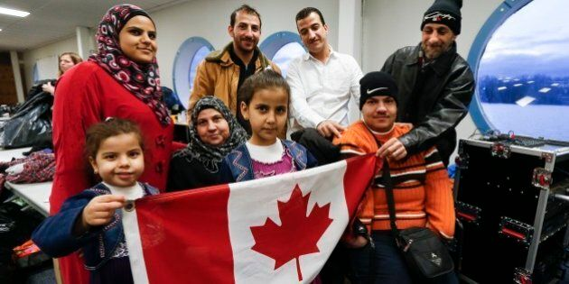 TORONTO, ON - DECEMBER 27:  A Syrian refugee family, sponsored by a local group called Ripple Refugee Project, pose for photos. Lots are: Reemas Al Abdullah, 5 (little girl), Sawsan Al Samman (red coat), Nahla Al Abdullah (older lady), Aya Al Abdullah, 8 (girl), Anais Al Abdullah (brown coat), Mohamad Al Abdullah (white shirt), Oais Al Abdullah (orange sweater) and Abdullah Al Abdullah (black coat). Friends of Syria hosted a dinner for refugees at the Toronto Port Authority.        (Bernard Weil/Toronto Star via Getty Images)