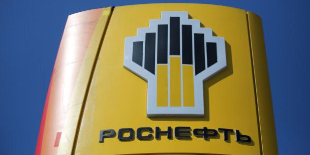 A logo sits on a sign outside an OAO Rosneft gas station in Moscow, Russia, on Friday, July 18, 2014....