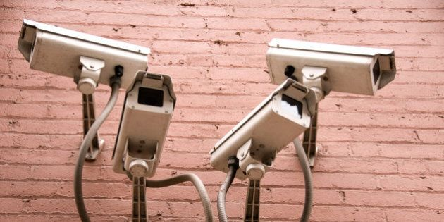Four security camereas on exterior wall of building