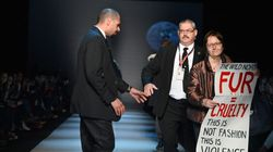 Protester Storms Runway At Toronto Fashion