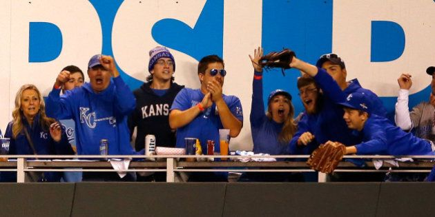 KANSAS CITY, MO - OCTOBER 23:  (2nd R) Caleb Humphreys, 19, of Blue Springs, Missouri, cheers after catching a home run ball hit by Mike Moustakas #8 of the Kansas City Royals in the second inning against the Toronto Blue Jays in game six of the 2015 MLB American League Championship Series at Kauffman Stadium on October 23, 2015 in Kansas City, Missouri.  (Photo by Jamie Squire/Getty Images)