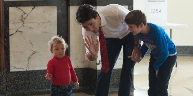 Canadian Liberal Party leader Justin Trudeau waits with his sons Hadrien (L) and Xavier to cast his ballot...