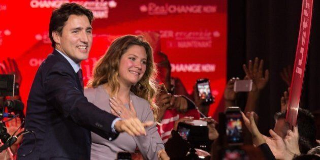 Canadian Liberal Party leader Justin Trudeau and his wife Sophie greet supporters in Montreal on October 20, 2015 after winning the general elections.    AFP PHOTO/NICHOLAS KAMM        (Photo credit should read NICHOLAS KAMM/AFP/Getty Images)