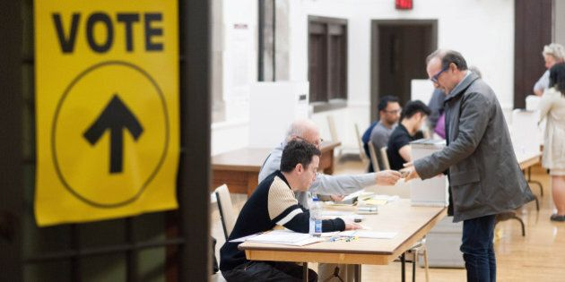 Voters cast ballots on election day in Toronto, Ontario, Canada, on Monday, Oct. 19, 2015. Canadians...