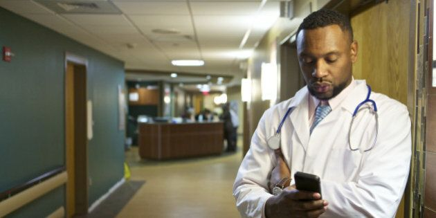 African American doctor standing in hospital