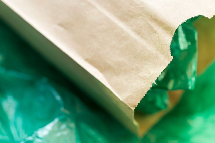 If you accept a paper or plastic bag at the grocery store, the best thing you can do is bring it home and reuse it as much as