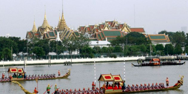 Ornate barges parade past the Grand Palace on the Chao Phraya River during rehearsal of Royal Barge Procession...