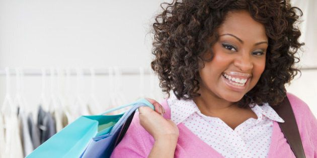 African American woman carrying shopping