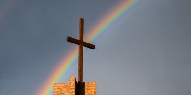 Rainbow behind a cross and grey