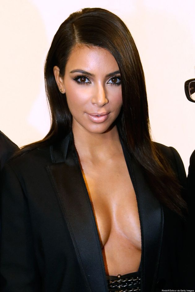 Kim Kardashian Lets Her Breasts Hang Out, But It's All An
