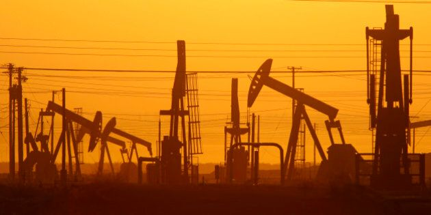 LOST HILLS, CA - MARCH 24: Pump jacks are seen at dawn in an oil field over the Monterey Shale formation...