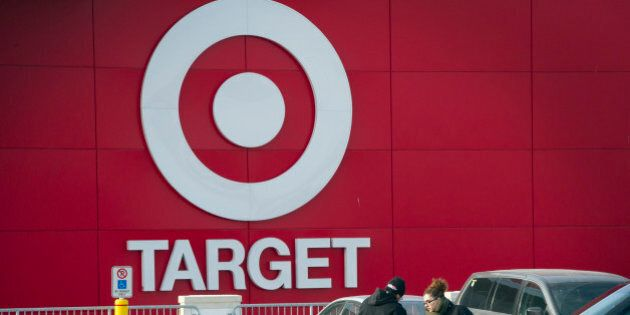 Shoppers unload a shopping cart after exiting a Target Corp. store in Toronto, Ontario, Canada, on Thursday,...