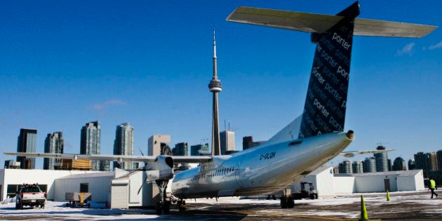 A Porter Airlines Bombardier Q400 turboprop aircraft is seen in Toronto February 23, 2009.  Just two years after launch, niche airline Porter Airlines now flies routes to eight cities in eastern Canada and the United States. It remains profitable and is gearing up for expansion at a time when industry rivals are strapped for cash.    REUTERS/Mark Blinch (CANADA)