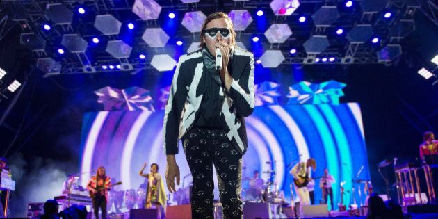 GLASTONBURY, ENGLAND - JUNE 27: Win Butler of Arcade Fire performs as the band headline the Pyramid Stage...