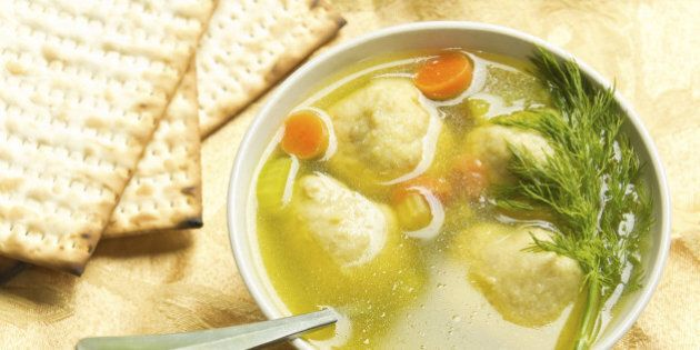Delicious Matzoh ball soup with crackers wine and