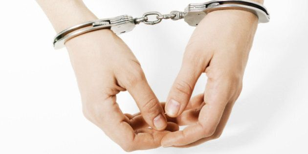 Handcuffed woman, close-up of