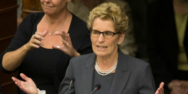 TORONTO, ON - JUNE 24 - Ontario Premier Kathleen Wynne addresses the audience after she and her cabinet...