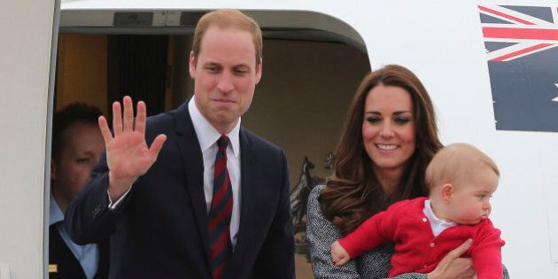 Britain's Prince William, left, and Kate, the Duchess of Cambridge, center, along with son Prince George,...