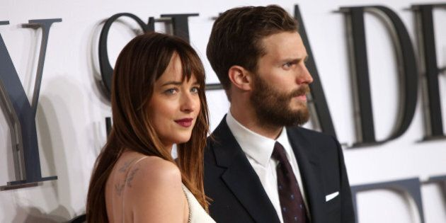 Jamie Dornan and Dakota Johnson pose for photographers upon arrival at the UK premiere of the film 'Fifty...