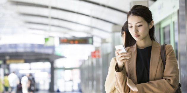 businesswoman checking a smart phone at
