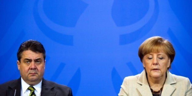 FILE - In this Jan. 23, 2014 file photo Chancellor Angela Merkel, right, and German Minister of Economics...