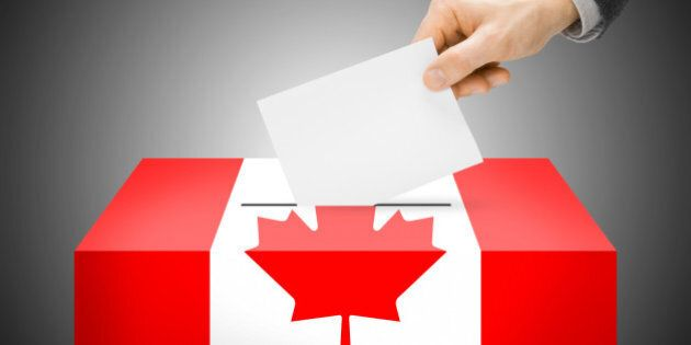 Voting concept - Ballot box painted into national flag colors - Canada