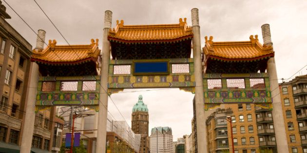 Pender Street leading through the Millennium Gate in Vancouver Chinatown with the Sun Tower in the