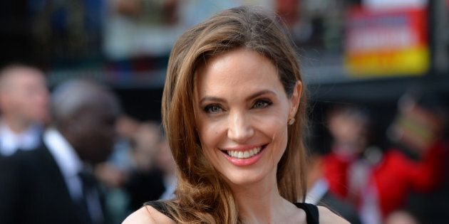 US actress and humanitarian campaigner Angelina Jolie poses as she arrives for the UK premiere of her...