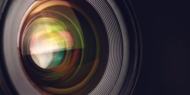 Camera lens detail, front glass of wide angle photography DSLR camera lens, macro shot