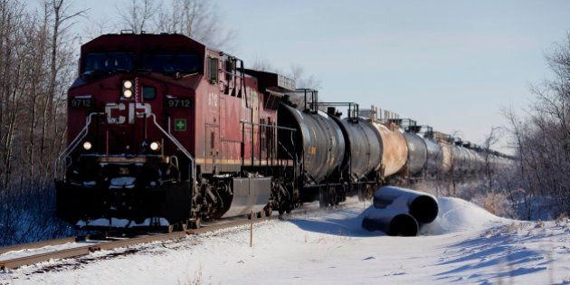 A Canadian Pacific Railway Ltd. train transporting oil leaves Hardisty, Alberta, Canada, on Saturday,...