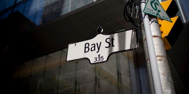 A 'Bay Street' sign hangs from a post in Toronto, Ontario, Canada, on Monday, June 17, 2013. The Canadian...