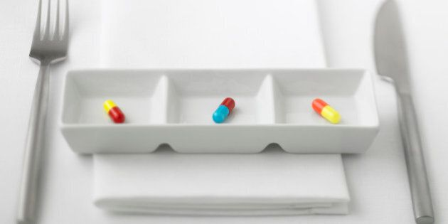 Close up of three pill capsules in sectioned