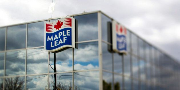 Maple Leaf Foods Inc. signage is displayed outside of the company's processing facility in the photo...