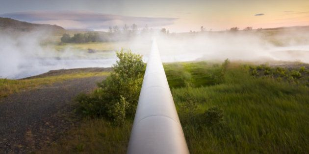 large heat pipeline disappearing at vanishing point in thermal steam