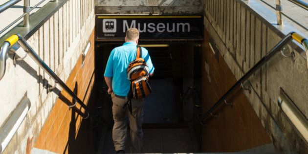 TORONTO, ONTARIO, CANADA - 2015/06/03: Toronto everyday scenes: Man walking down the stairs of the underpass...